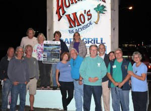 The members of the OBX Parrot Head Club present the donation to Chris Pruitt, N.E.S.T. Treasurer, with George and Dennis N.E.S.T. members standing by with smiles.