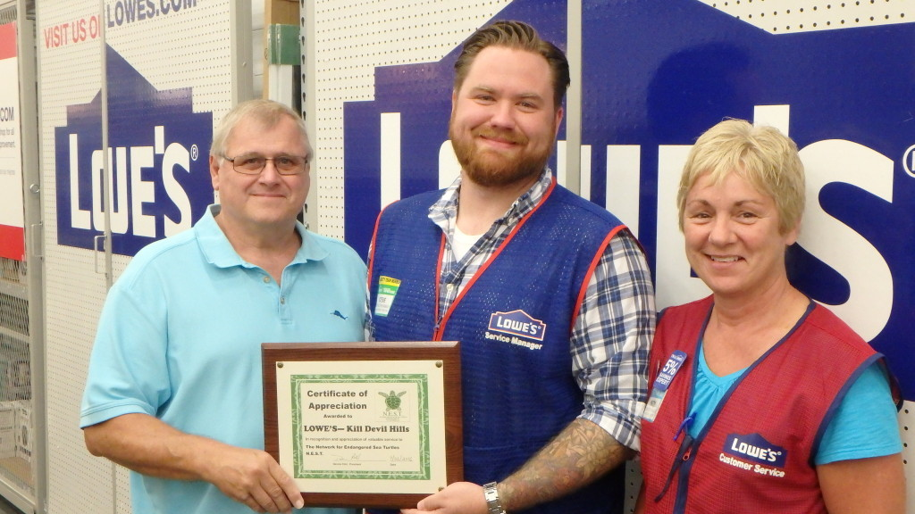 Dennis Pohl, N.E.S.T. on behalf of N.E.S.T. members thank Steve Sanders, Lowe's of Kill Devil Hills Assistant store manager and Patty Sansotta, Human Resource Manager for their support.