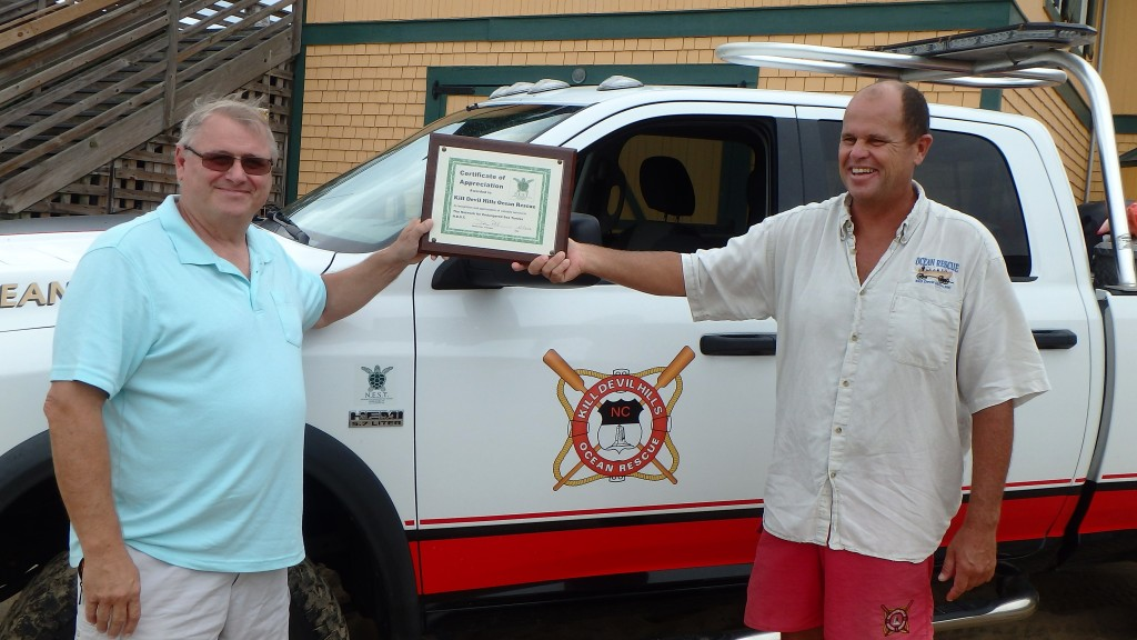 Dennis Pohl (left) N.E.S.T. presents certificate of appreciation to Supervisor Dave Elder, Kill Devil Hills Ocean rescue.