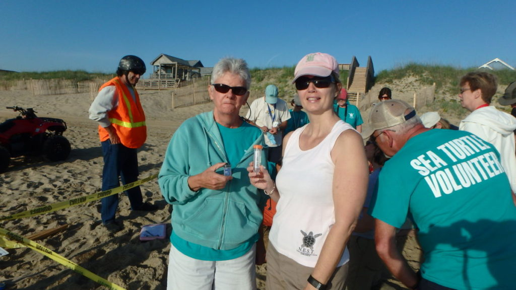 Margaret (left) holds the data logger for placement in the nest. Stephenie (right) holds the DNA egg vial at the ready.