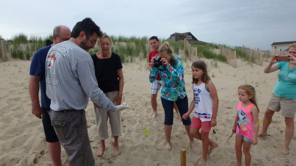 John shows the DNA sea turtle egg to visitors